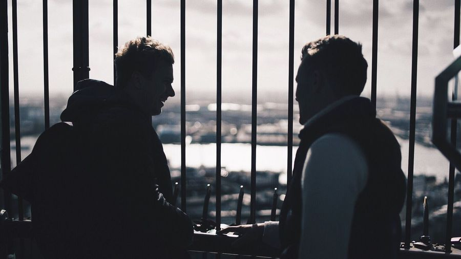 Close-up of silhouette men on window