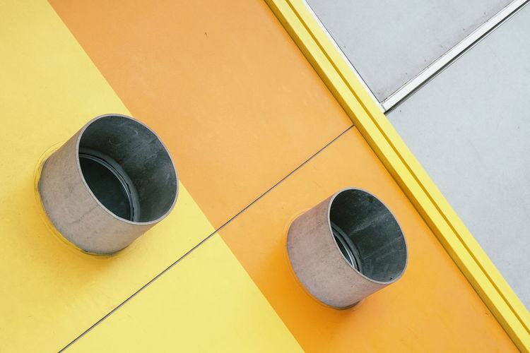 High angle view of yellow shoes on wall