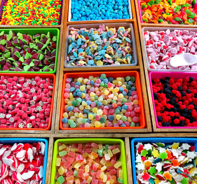 Variety of multi colored jelly candies in a candy shop Bonbon Bright Colors Candy Chewycandy Choice Closeup Colorful Confection Confectionery Delicious Diversity For Sale Heap Jelly Candy Jujube  Lot Marmalade Multi Colored Multicolored No People Retail  Sugared Sweet Variation Variety