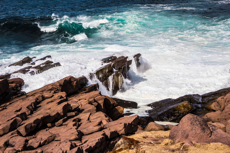 ROCKMEETSWATER Bright Aquatic Sport Beach Beauty In Nature Breaking Crashing Waves  Day Flowing Water Hitting Land Motion Nature Outdoors Power In Nature Rock Rock - Object Rock Formation Rocky Coastline Scenics - Nature Sea Solid Sport Surfing Water Wave