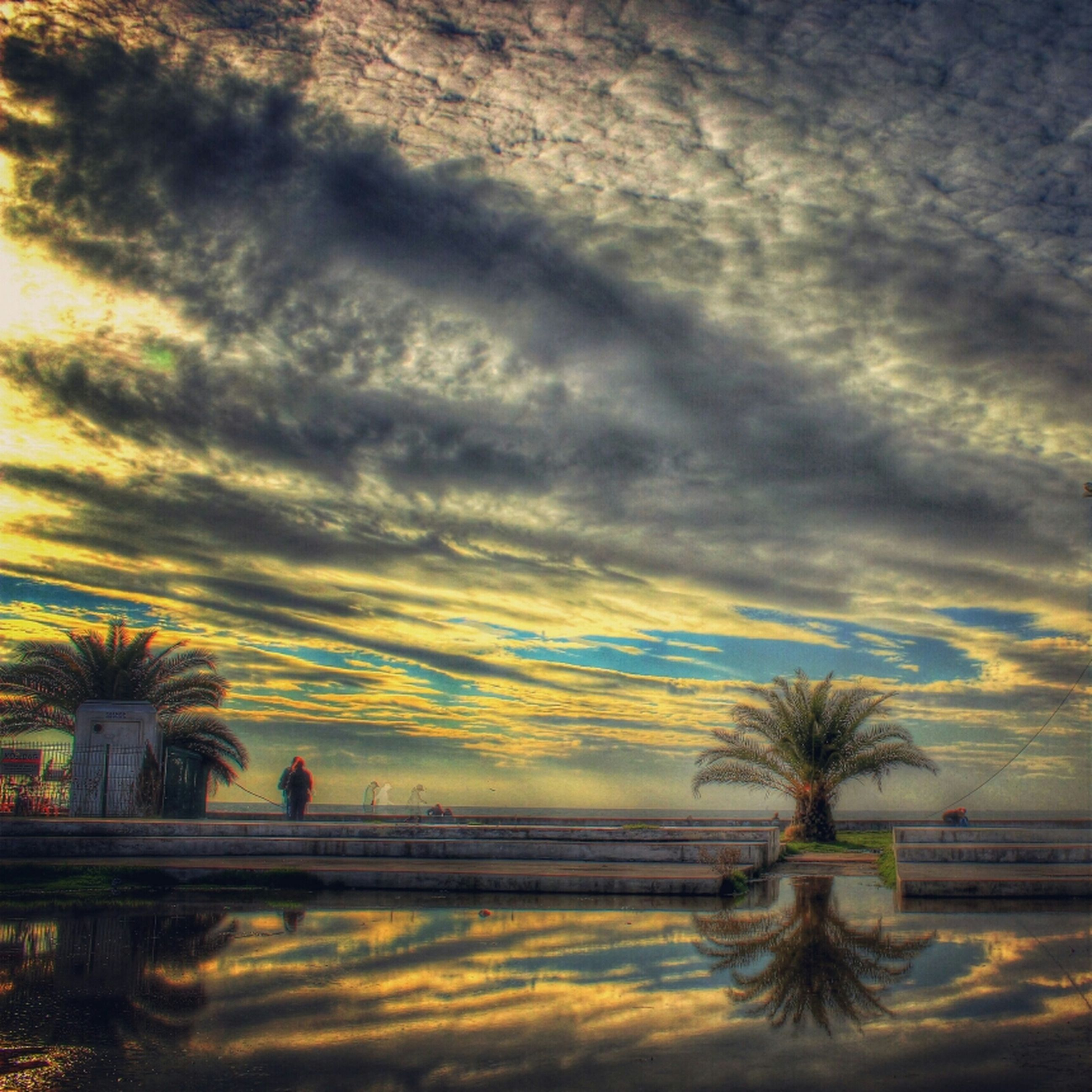sky, sunset, tranquil scene, tranquility, water, scenics, cloud - sky, beauty in nature, palm tree, nature, tree, cloudy, sea, silhouette, idyllic, horizon over water, cloud, beach, weather, dramatic sky