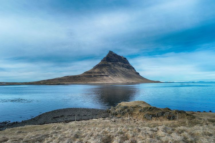 Kirkjufell Iceland Iceland Kirkjufell SamsungNX500 Beach Beauty In Nature Cloud - Sky Day Idyllic Land Mountain Mountain Peak Nature No People Non-urban Scene Outdoors Rock Rock - Object Scenics - Nature Sea Sky Tranquil Scene Tranquility Water