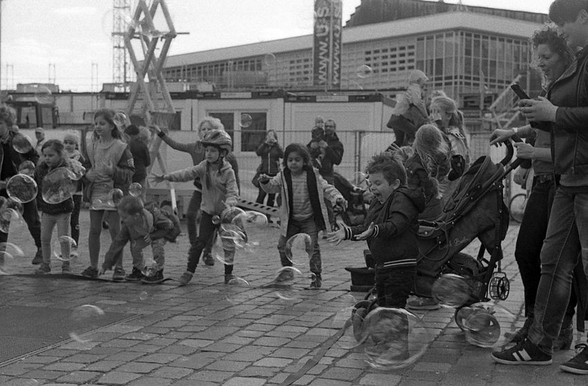 Little people and their little pleasures. 35mm Film Black And White Children Excitement Film Photography Happiness Helios 44-2 2/58mm Kodak Tri-X 400 Soap Bubbles Street Photography The Street Photographer The Street Photographer - 2017 EyeEm Awards
