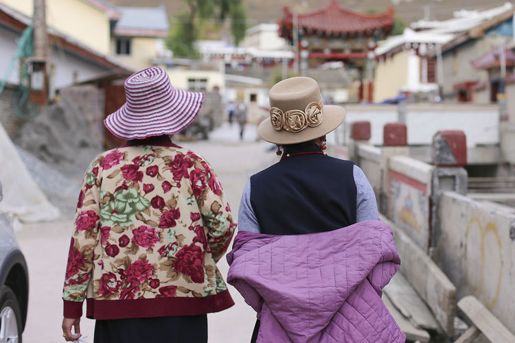 Rear view of people in wearing hat