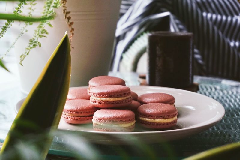 Macaroons in plate on table