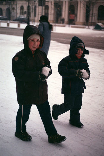 Analogue Photography Kids Snow ❄ Warsaw Boys Childhood Cold Temperature Glove Mischievous Outdoors Playful Smiling Snow Snow Covered Snowball Snowing Street Streetphotography Warm Clothing Winter The Week On EyeEm EyeEmNewHere Film Photography Film