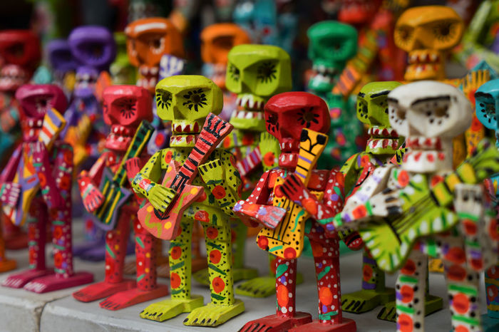 Chichicastenango Chichicastenango Market Scene Chichicastenango, Guatemala Colors Skeleton Abundance Childhood Colorful Figurine  For Sale Human Representation In A Row Indoors  Large Group Of Objects Male Likeness Market Multi Colored No People Retail  Skeletons Skull Skulls Skulls And Bones Toy Variation