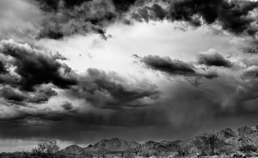 Rocky mountains against cloudy sky