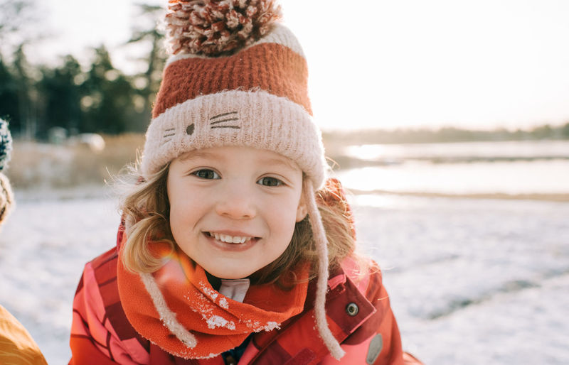 Portrait of smiling boy in snow