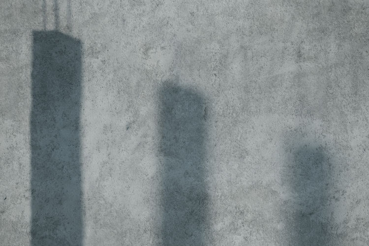shadows of concrrete pillars projected on concrete wall Textured  Shadow Concrete Pillars Architecture Concrete Pattern Backgrounds Backdrop Copy Space Abstract Concrete Wall Simplicity Cement Gray Wall Construction Pillars Industrial Three Sunlight