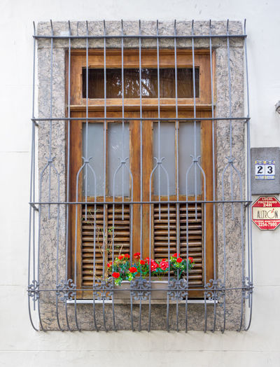Architecture Building Exterior Built Structure Day Façade Flower No People Outdoors Security Bar Window Window Box