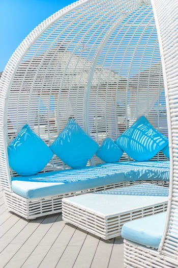 Lounge chairs by swimming pool