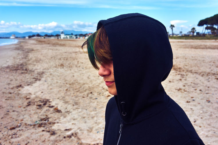 Young Man Wearing Hood At Beach