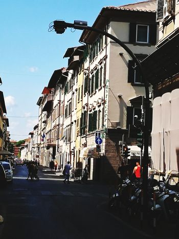 Italy Ancient Architecture Sun Community Urban Human Street Streetphotography Florence Florence Italy City Sky Building Exterior Architecture Built Structure Old Town Townhouse TOWNSCAPE Housing Settlement People In The Background