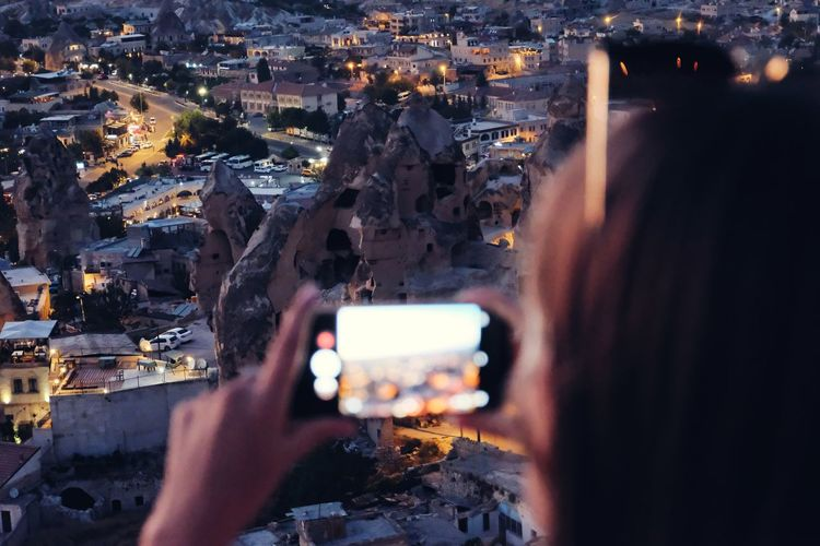 Close-up of woman photographing cityscape
