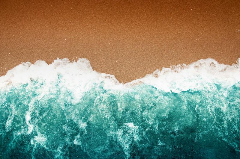 Close-up of sea waves splashing on shore