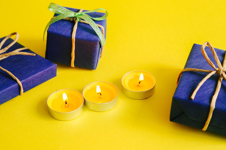 Colors Still Life Studio Shot Light Candle Aroma Arrangement Candlelight Decoration Romantic Wax Spa Relaxing Colored Background Yellow Ribbon - Sewing Item Gift Box Bow Group Of Objects
