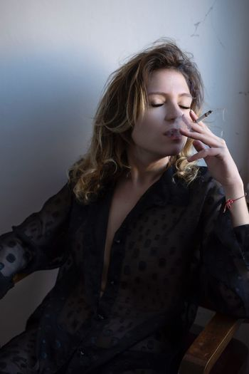 Speak to me when I'm done smoking EyeEm Best Shots My Best Photo Eye4photography  One Person Young Adult Adult Lifestyles Hair Leisure Activity Real People Smoking - Activity Women Cigarette  International Women's Day 2019