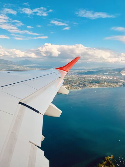 Going home Airplane Air Vehicle Sky Mode Of Transportation Transportation Water Cloud - Sky Aircraft Wing Nature No People Day Flying Mid-air Beauty In Nature Outdoors Travel Winglet Wingview Wing View Lake View Lake Horizon Horizon Over Water