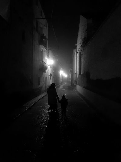 Siluetas en el pueblo OutdoorsNight Real People People Illuminated Woman And Baby Young Women Silhouette EyeEmNewHere Mobile Conversations Piano Moments Welcome To Black Long Goodbye