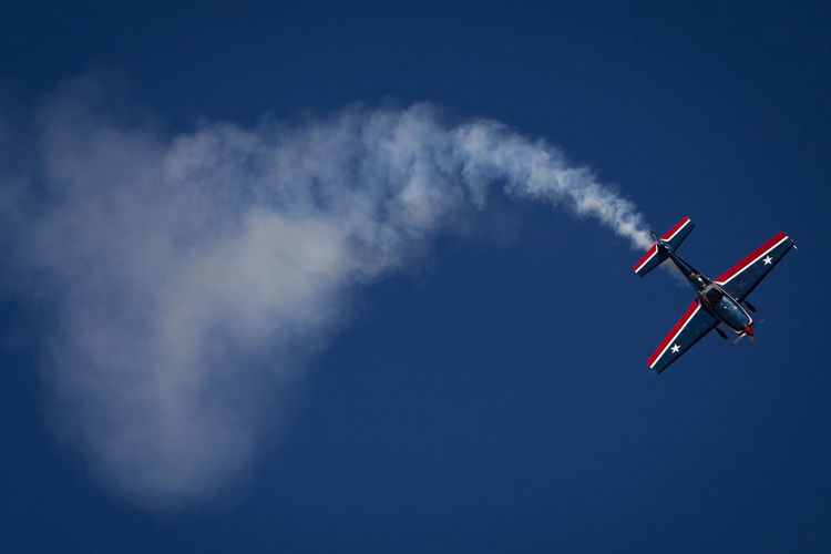 Low Angle View Of Airplane Against Sky During Airshow