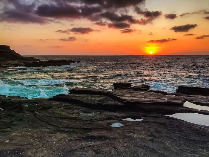 Oahu, Hawaii Sunset Sea Beach Beauty In Nature Orange Color Nature Water Scenics Sky Horizon Over Water Sun Cloud - Sky Tranquil Scene Sand Tranquility No People Outdoors Sunrise