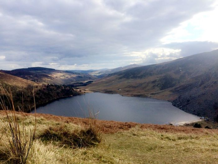 Lough Tay Guinness lake Beauty In Nature Nature Tranquil Scene Mountain Scenics Water Lake Tranquility Landscape Grass Day Sky No People Cloud - Sky Outdoors Travel Destinations
