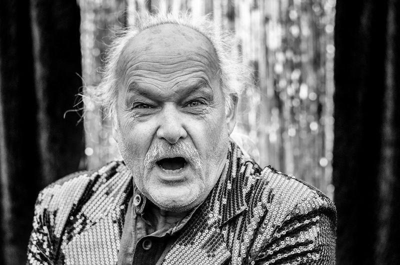 Close-Up Portrait Of Senior Entertainer At Event