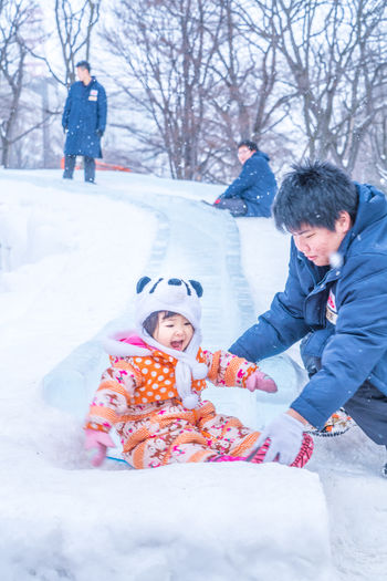 Sapporo Snow Festival Feb 2018 Fun Japan Japan Photography Japanese  Sapporo,Hokkaido,Japan Snow ❄ Bonding Candid Child Childhood Clothing Cold Temperature Daughter Emotion Family Family With One Child Father Females Males  Men Parent Positive Emotion Sapporo Snow Snow Covered Snowing Son Togetherness Warm Clothing Winter