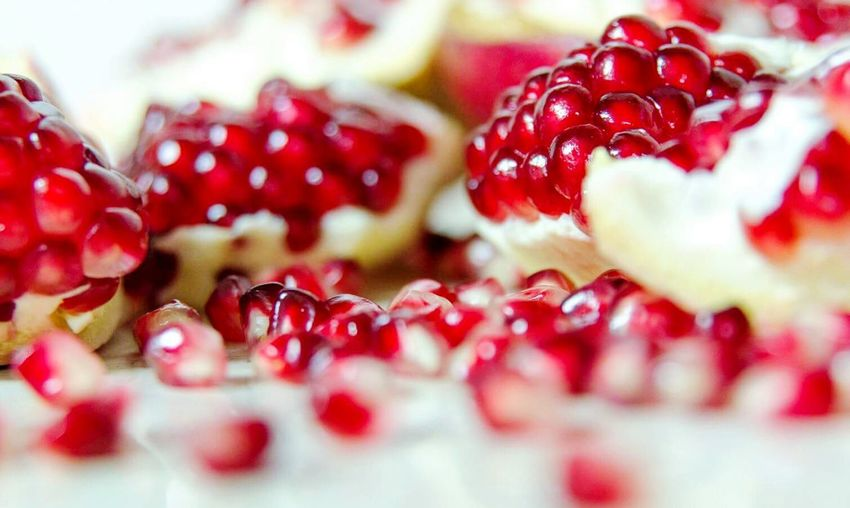 Close-up of pomegranate seeds in plate