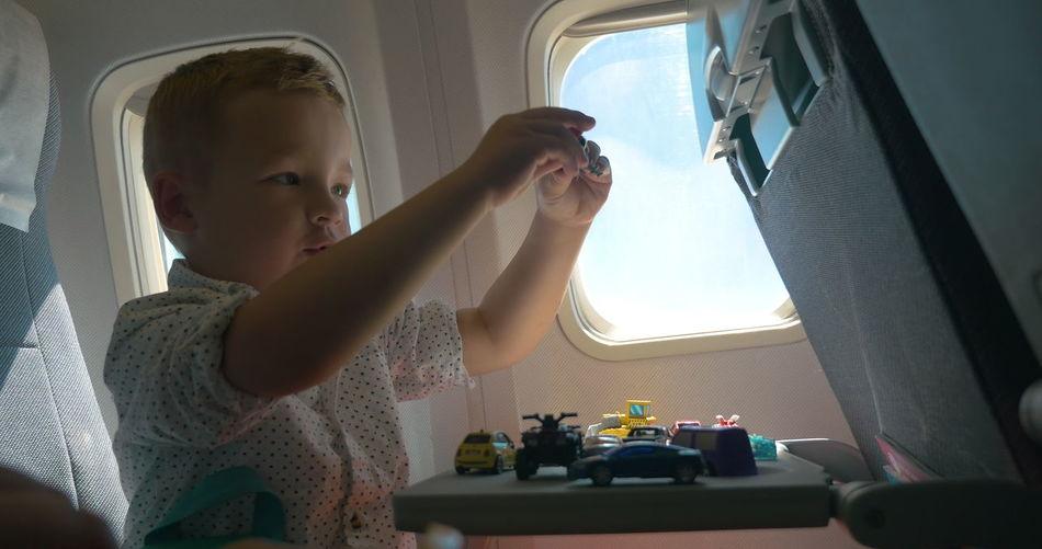 Portrait of boy in airplane