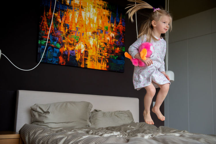 little attractive girl jumping on the bed Bedroom Bed Bedtime Little Girl Toy Furniture One Person Domestic Room Childhood Girls Child Lifestyles Real People Jump In Jump Jumping Hairstyle Long Hair Home Home Sweet Home Morning Routine Morning Routine Happiness Springtime Decadence