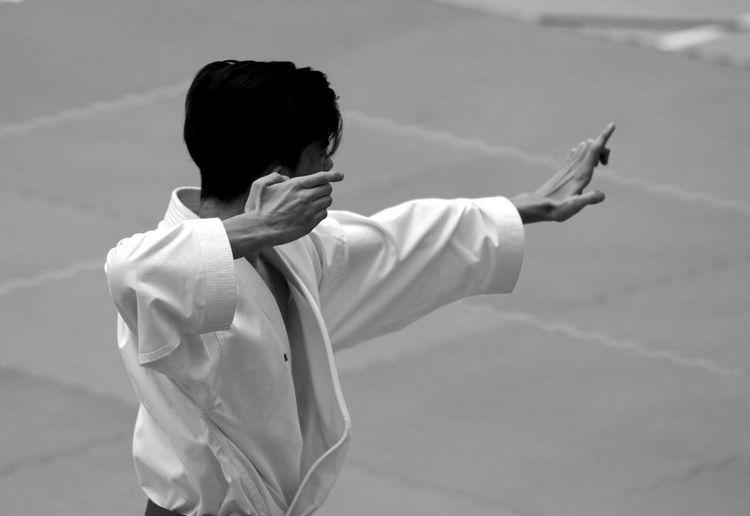 Mature Man Practicing Karate Outdoors