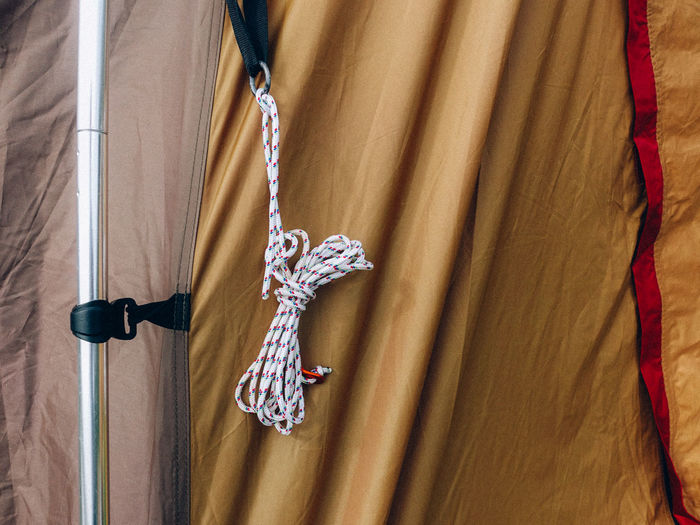 Hanging Chain No People Textile Curtain Indoors  Close-up Necklace Pattern Jewelry Full Frame Wood - Material Day Rope Clothing Cross Decoration Backgrounds Low Angle View Personal Accessory Rope Tied Up Sorting  Tent