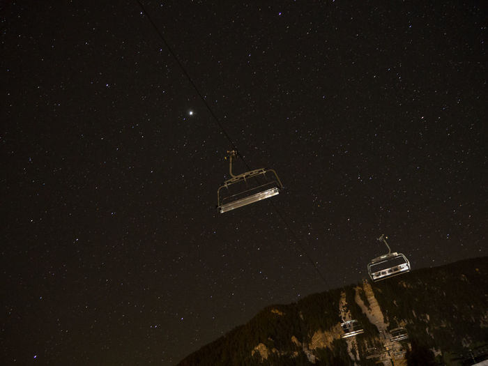 Ski Lifts Against Star Field At Night