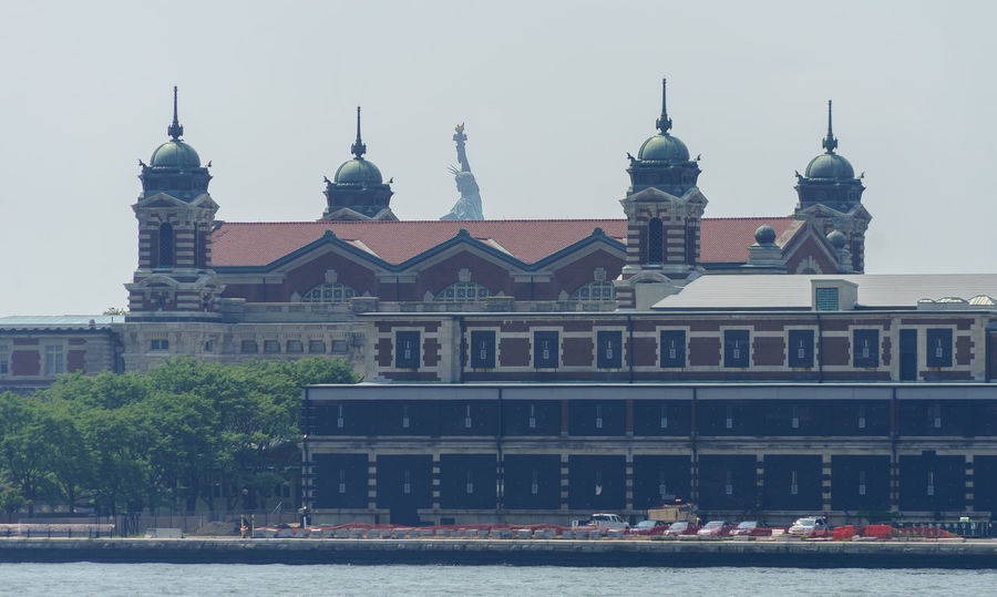 American Ellis Island  New Jersey New York New York City Statue Of Liberty USA Architecture Building Exterior Built Structure City Day Dome Hall History Museum No People Outdoors Place Of Worship Registration Sky Travel Destinations Tree Water Waterfront