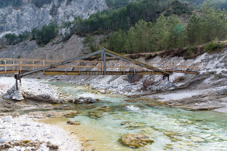 Erve Erve Miozzo Photo Miozzo Connection Bridge Water Bridge - Man Made Structure Mountain Plant Architecture Tree Built Structure Day Non-urban Scene Nature Scenics - Nature Beauty In Nature Rock River No People Land Rock - Object Outdoors Flowing Water Footbridge Power In Nature Hot Spring Flowing
