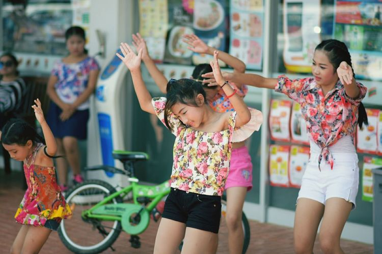Thai dane Songkhan Three Quarter Length Fun Enjoyment Girls Excitement Child Arms Raised Happiness Smiling Focus On Foreground Cheerful People Females Women Togetherness Young Women Outdoors Childhood Adult Human Arm