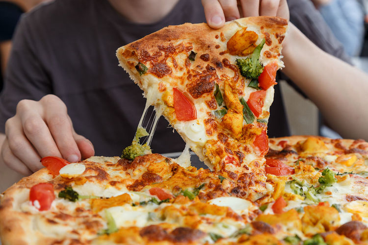 Pizza Cafe Travel Baked Holding Front View Italian Eating Appetite Ready-to-eat Pizzeria Gourmet Fast Food Human Hand Unhealthy Eating Human Body Part Restaurant SLICE Food Italian Food Fast Food Food And Drink Snack Vacation Meal Fresh On Market 2017