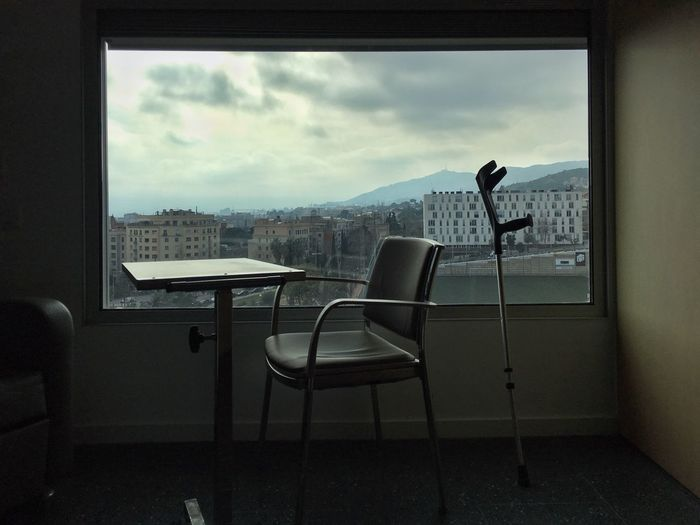 Chairs and table by window