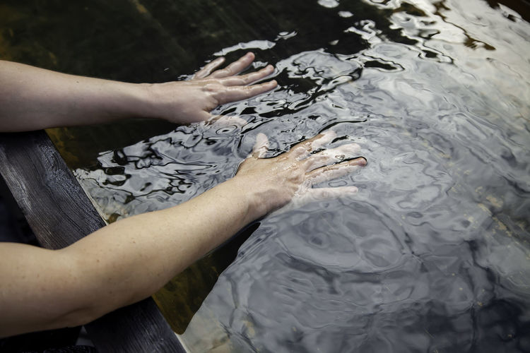 Cropped image of hands in water
