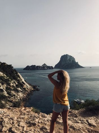 Life begins at the end of your comfort zone Summer Enjoy Salty Hair  Happiness Ibiza Point Es Vedrá Sky Real People Leisure Activity Beauty In Nature Standing Lifestyles One Person Rear View Day Sunlight Horizon Over Water Women