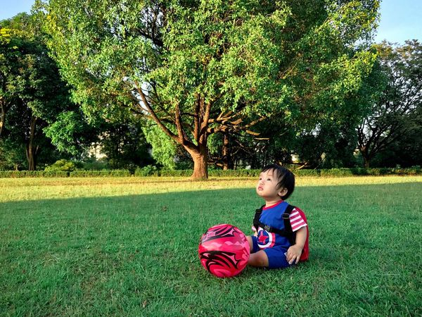 Little baby Love Relaxing People Toy Playing Growth Son School Background Future Still Life ASIA Happiness Kids Child Childhood Plant One Person Full Length Tree Grass Real People Boys Leisure Activity Innocence Outdoors Green Color Sitting Nature Casual Clothing