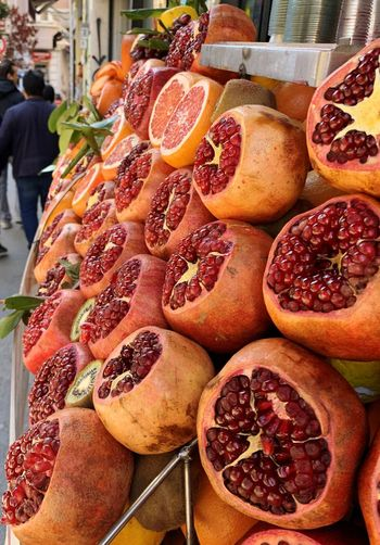 Food And Drink Food Freshness Market For Sale Fruit Market Stall Wellbeing Retail  Day Healthy Eating High Angle View Incidental People Still Life Abundance Arrangement Real People Large Group Of Objects Pomegranate