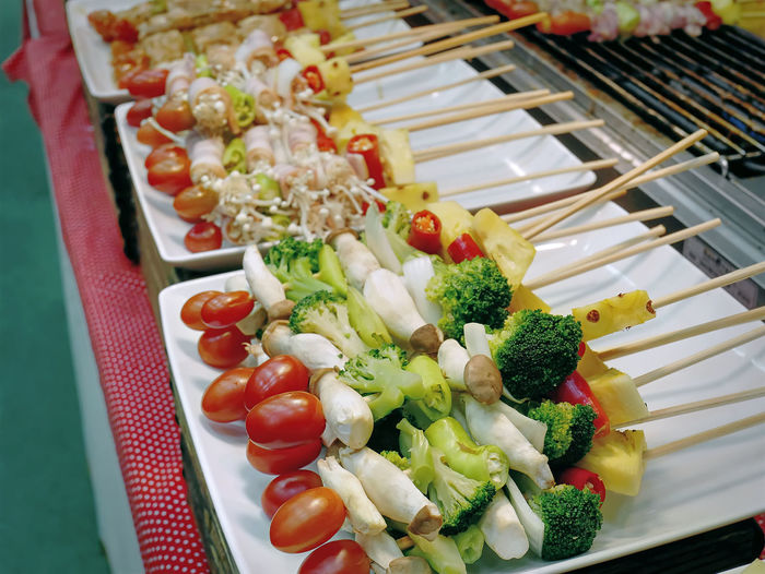 High Angle View of Vegetable Barbecue Sticks Ready to Grill Barbecue Broccoli Chopped Close-up Food Food And Drink Freshness Healthy Eating High Angle View Indoors  Meal No People Onion Plate Ready-to-eat Salad Selective Focus Serving Size Still Life Sweetcorn Tomato Tray Vegetable Vegetarian Food Wellbeing