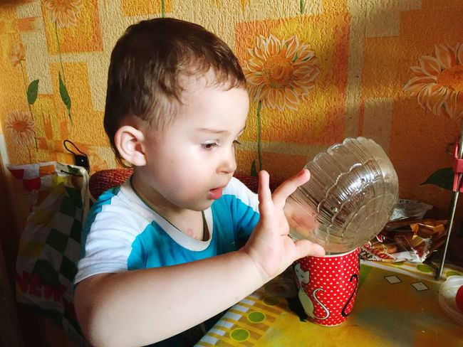 EyeEm Selects Childhood Boys One Person Real People Indoors  Headshot Drinking Glass Food One Boy Only Day Freshness People boy, kitchen, playing, fun, water, pour, table, mug, plate, laughter, emotions, excitement, passion First Eyeem Photo
