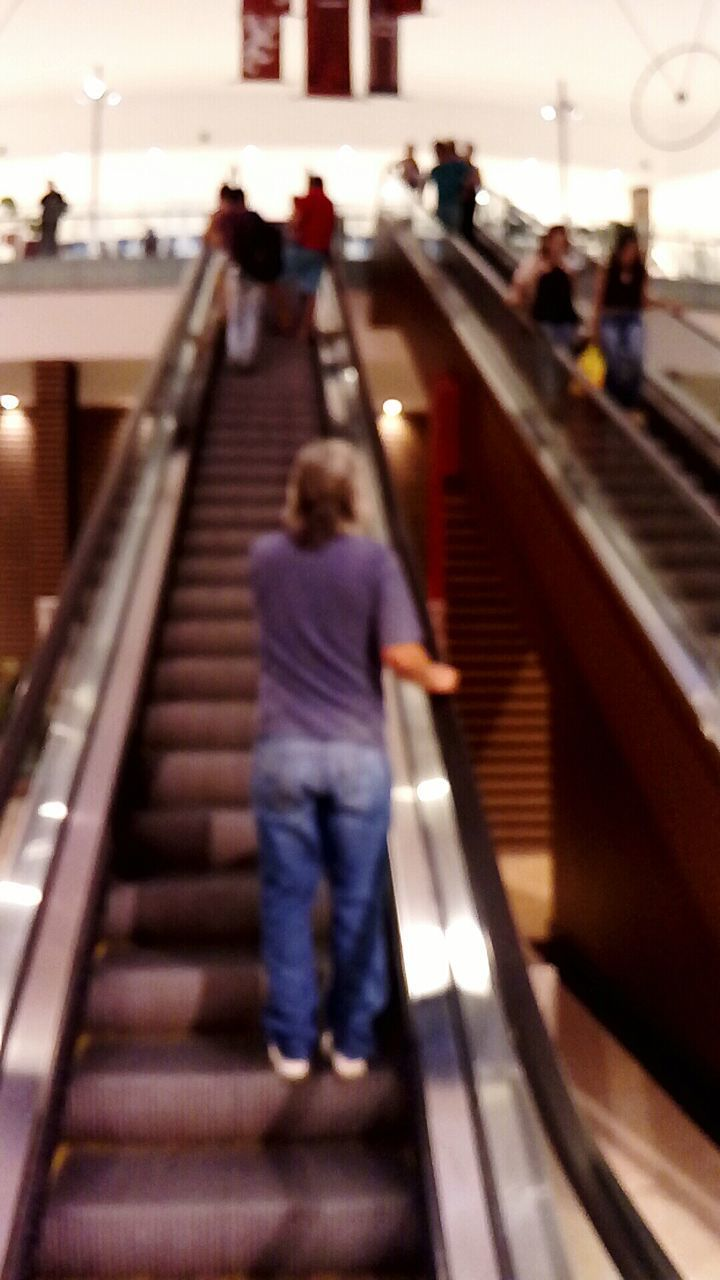 steps and staircases, staircase, steps, real people, rear view, the way forward, railing, walking, full length, transportation, escalator, stairs, built structure, women, men, lifestyles, indoors, architecture, childhood, hand rail, large group of people, technology, day, people