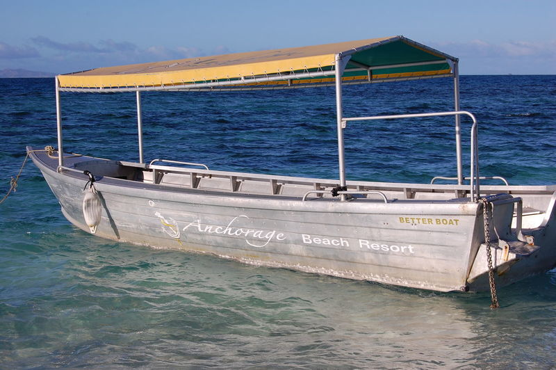 Sea Water Nautical Vessel Sky Mode Of Transportation Nature Transportation No People Waterfront Scenics - Nature Beauty In Nature Day Outdoors Horizon Horizon Over Water Text Travel Moored Motion Fiji Beachcomber Island Tropical Climate