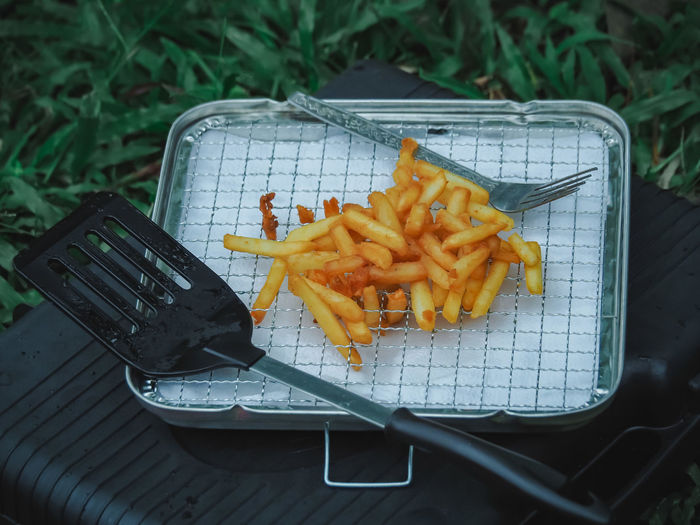 french fried fry in a tray. Prepared Potato French Fries Potato High Angle View Fast Food Food Food And Drink Unhealthy Eating No People Ready-to-eat Close-up Fried Day Container Nature Table Focus On Foreground Freshness Metal Yellow Snack Tray Temptation Fast Food French Fries