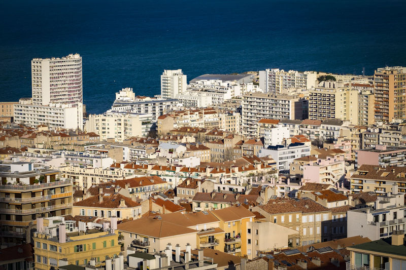 Aerial view of Marseille, France, from Notre-Dame de la Garde France France Marseille Mediterranean  Architecture Building Exterior Built Structure City Cityscape Crowded Day Europe High Angle View Outdoors People Residential Building Sea Sky Town